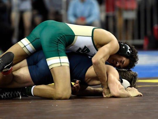 St. Joseph Regional's Sammy Alvarez, top, wrestles