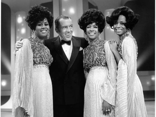Diana Ross and the Supremes on stage with Ed Sullivan in 1969.