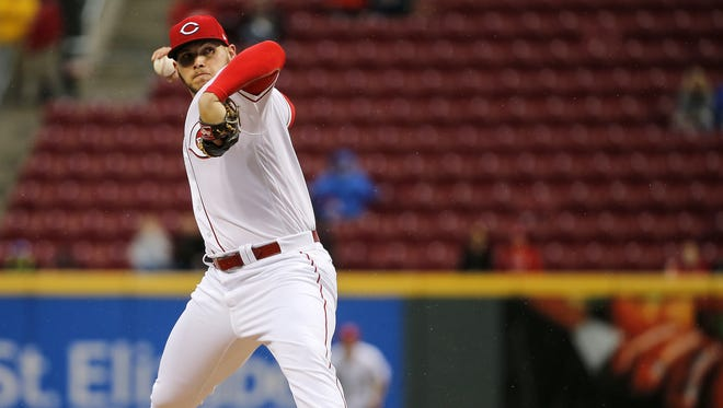 Cincinnati Reds starting pitcher Rookie Davis (54) delivers in the first inning.