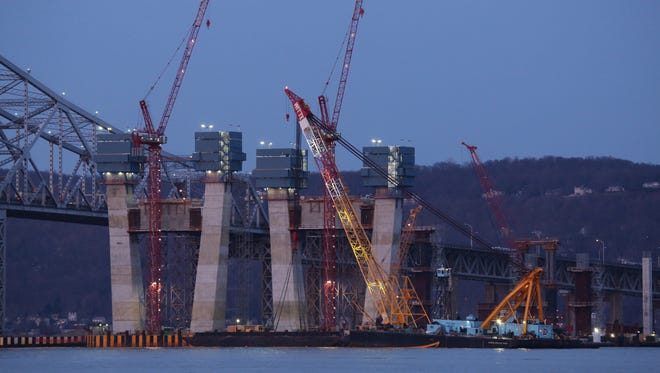 A crane prepares to raise the wreckage of sunken tugboat Specialist from the bed of the Hudson River near the Tappan Zee Bridge on Thursday, March 24, 2016.