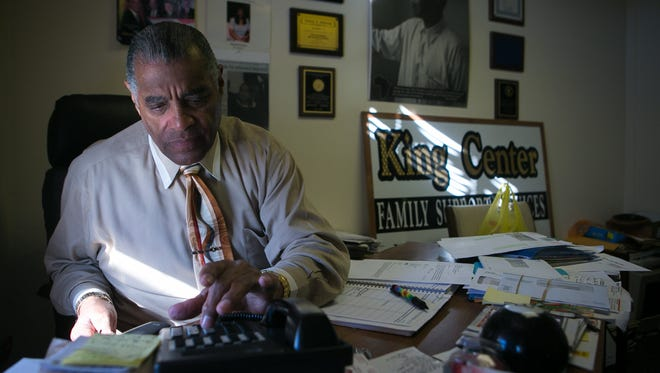 Herman Holloway, Jr., chairman of the board for the Wilmington Housing Authority, works in his office in New Castle.