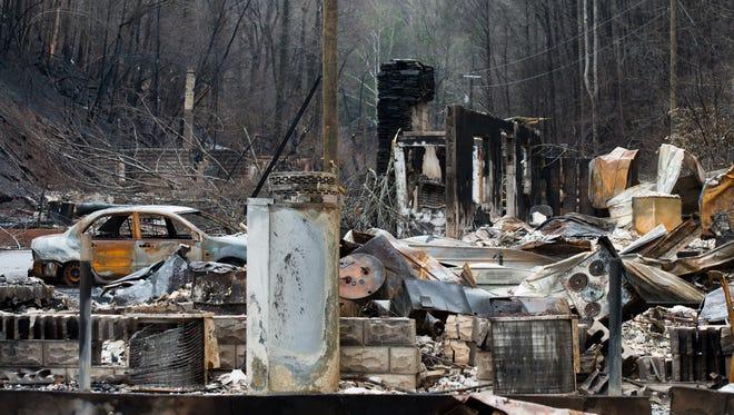 Destroyed homes near the downtown area of Gatlinburg, Tenn., Monday, Dec. 5, 2016.