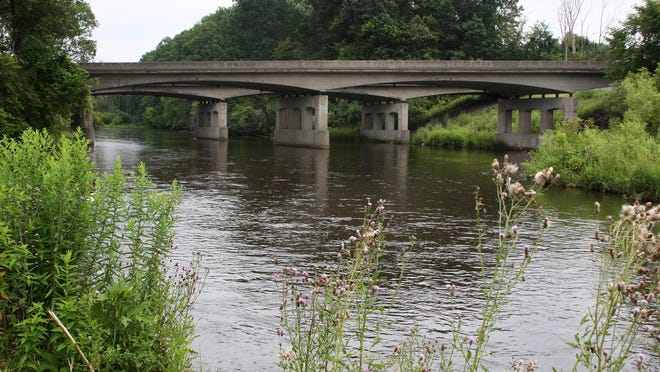 I-94 spans the Kalamazoo River just upstream from Historic Bridge Park. The river looks pristine on the surface, but oil remains in pockets and in sediments five years after the Enbridge Inc. spill.