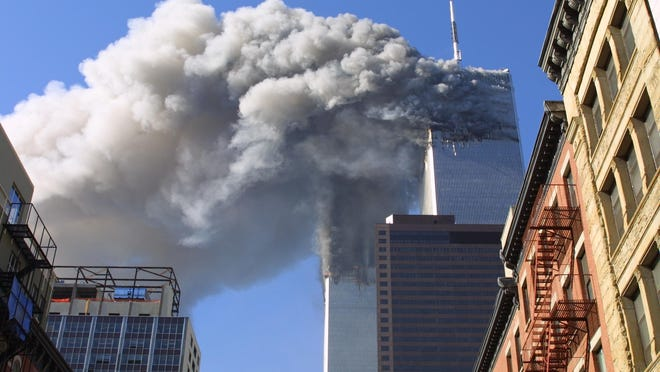 In this Sept. 11, 2001 file photo, the twin towers of the World Trade Center burn after hijacked planes crashed into them in New York.
