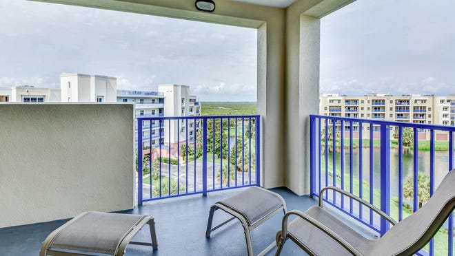 The extra-large master suite has entrances to both the large front balcony to welcome the sunrises and the back balcony to enjoy the sunsets.