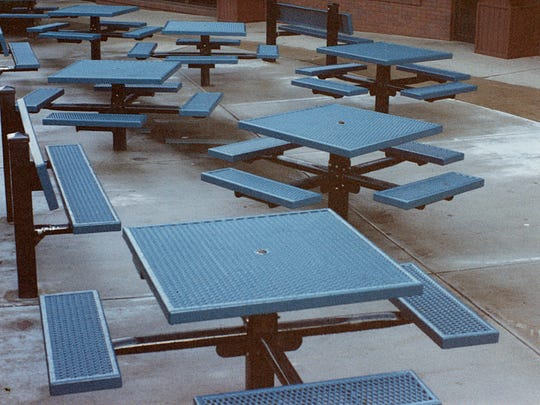 In this shot from the late-1990s, benches and tables outside Garcia's Pizza in a Pan served as the meeting place for teens who hung out at Chauncey Hill Mall in West Lafayette.