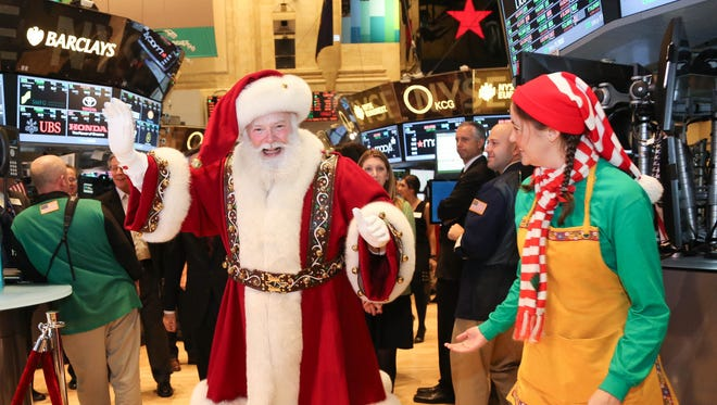 Santa Claus and the 87th Annual Macy's Thanksgiving Day Parade visits the New York Stock Exchange on Nov. 27.