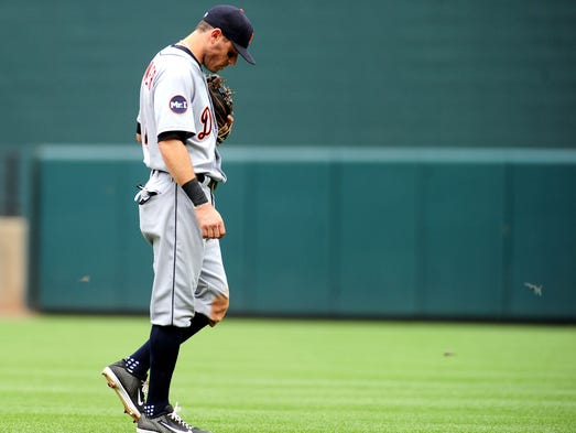 Tigers second baseman Ian Kinsler (3) looks on during