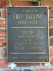 An old plaque reflects the center's progressive roots.