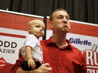 """Cincinnati Reds third baseman Todd Frazier strikes the """"Toddfather"""" persona after answering questions from the media."""