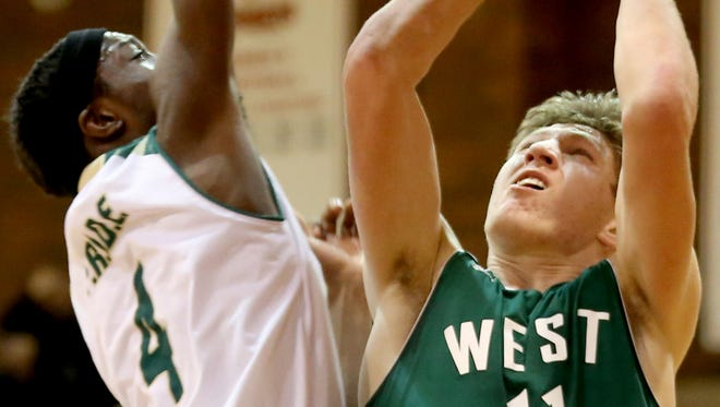 West Salem's Jared Oliver (11) goes for the basket past an Evergreen player in the West Salem vs. Evergreen boy's basketball game on the first day of the Capitol City Classic tournament at Willamette University in Salem on Wednesday, Dec. 21, 2016. West Salem won the game 72-52.