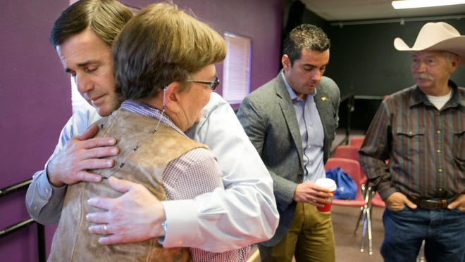 Gov. Doug Ducey hugs Cochise County rancher Sue Krentz. Her husband, Rob Krentz, was shot to death in 2010 on their ranch near the border with Mexico.