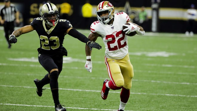 Former San Francisco 49ers running back Matt Breida (22) runs with the ball past New Orleans Saints cornerback Marshon Lattimore (23).