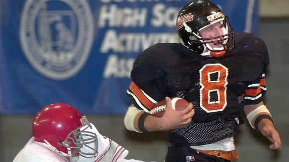 Stickney/Mt. Vernon quarterback Chad Greenway crosses the goal line in front of Gettysburg's Cody Donovan for a first quarter touchdown during the 9AA football championship game in 2000.