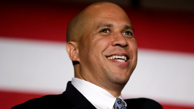 Sen. Cory Booker, D-N.J. addresses supporters during an election night victory gathering, Tuesday, Nov. 4, 2014, in Newark, N.J. Booker, who won a special election last year for the seat that was vacated by the death of Sen. Frank Lautenberg, went up against Republican challenger Jeff Bell.