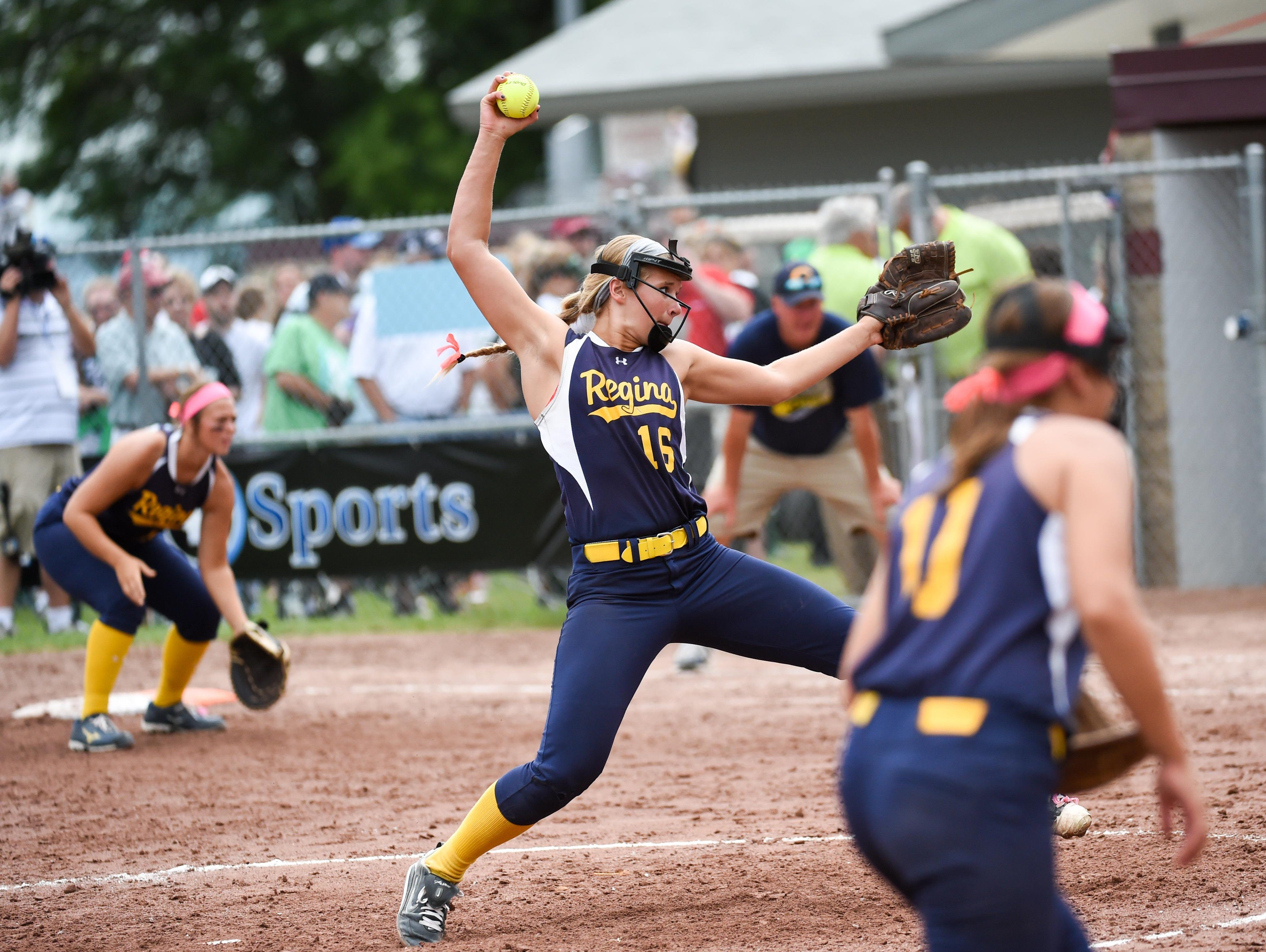Iowa City Regina's Sarah Lehman winds up to throw the final pitch of the game on Friday as the Regals secured the Class 2A state softball title. Lehman recorded 12 strikeouts.