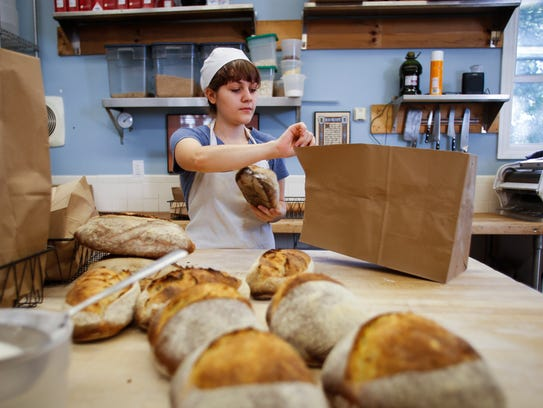 Emily Walkowski of Stone Circle Bakehouse in Holt packages