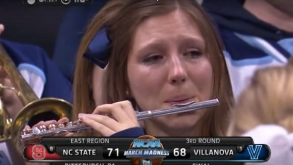 The 15 best characters, memes and bawling adults from NCAA tournament history