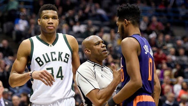 Feb 26, 2017; Milwaukee, WI, USA;  Referee Tre Maddox separates Milwaukee Bucks forward Giannis Antetokounmpo (34) and Phoenix Suns forward Marquese Chriss (0) in the third quarter at BMO Harris Bradley Center. Mandatory Credit: Benny Sieu-USA TODAY Sports