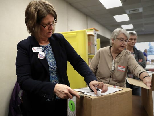 Outagamie County Clerk Lori O'Bright opens a box of ballots last week at the start of the Outagamie County presidential election recount in Little Chute.