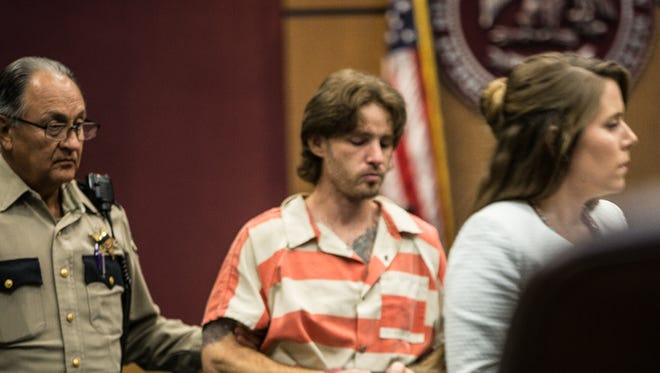 James Nelson, center, is escorted to court with Public Defender Amanda Skinner, right, August 18, 2016.