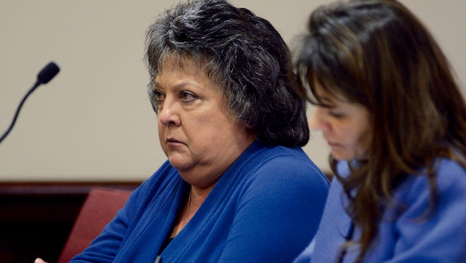 Former New Mexico Secretary of State Dianna Duran, left, sits with her attorney Erlinda Johnson in District Judge Glenn Ellington's court on Friday in Santa Fe.