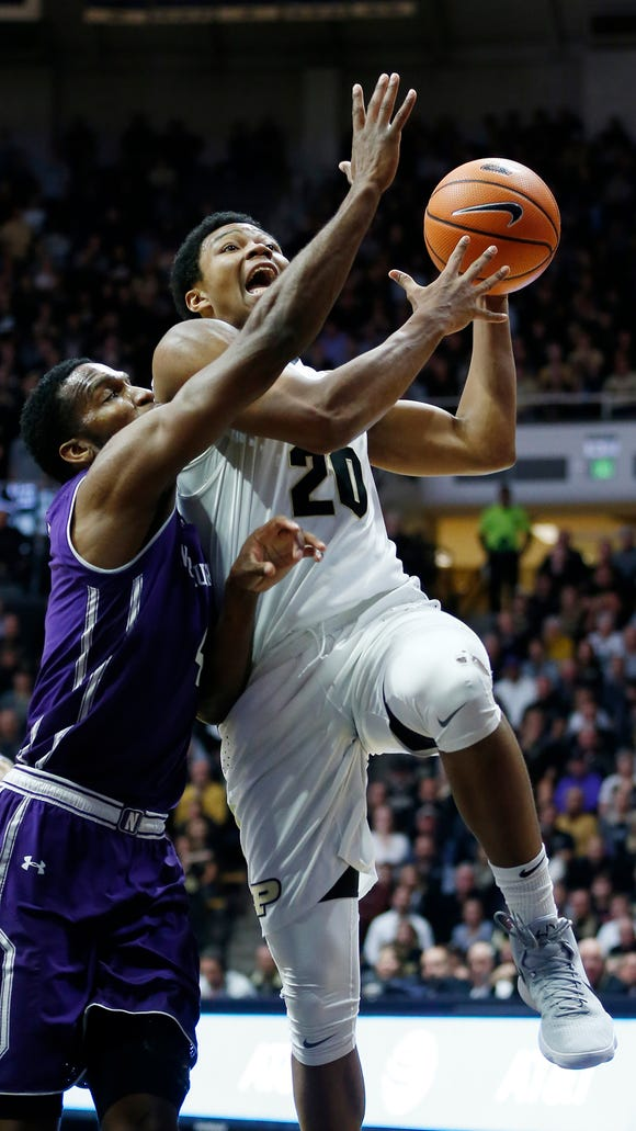 Nojel Eastern of Purdue with a drive to the basket against Vic Law of Northwestern Sunday, December 3, 2017, at Mackey Arena. Purdue defeated Northwestern 74-69.
