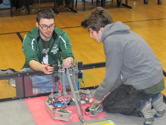 Mt. Pleasant seniors Jacob Cline, left, and Donovan Roman compete at the VEX robotics tournament Feb. 11.