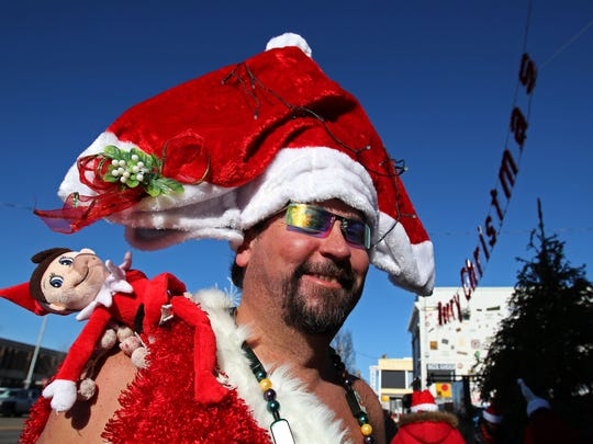 Santacon participant Toby Keith of Neptune,  drops off a food donation for the Christmas holiday, at Johnny Mac House of Sprits. Saturday, December 13, 2014.Noah K. Murray-Special for the Asbury Park PressASB 1214 Santacon