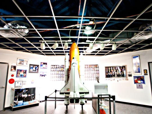 Guests are greeted by a rocket ship on the second floor of the Challenger Space Center.