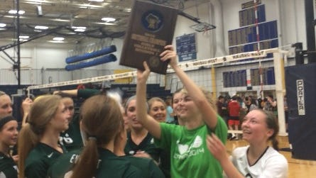 Members of the D.C. Everest volleyball team celebrate after winning a sectional championship Saturday