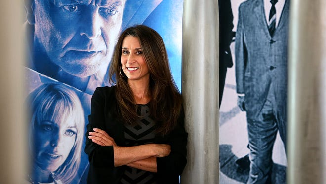 Surrounded by movie posters from some of her movies, Germantown entrepreneur Marie Pizano has raised $20 million and plans to film five full-length movies in Memphis and the Mid-South.