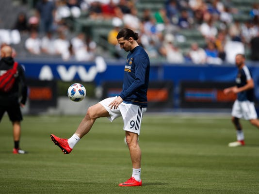 Los Angeles Galaxy's Zlatan Ibrahimovic, of Sweden, warms up before the team's MLS soccer match against the Los Angeles FC, Saturday, March 31, 2018, in Carson, Calif. (AP Photo/Jae C. Hong)