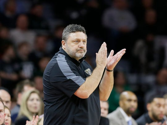 Oakland head coach Greg Kampe watches during the first half of an NCAA college basketball game against Michigan State, Tuesday, Dec. 22, 2015, in Auburn Hills, Mich.