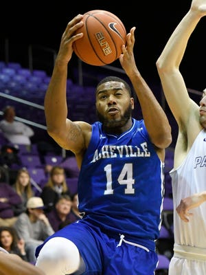 Ahmad Thomas (14) scored 18 points in UNC Asheville's romp over Wofford