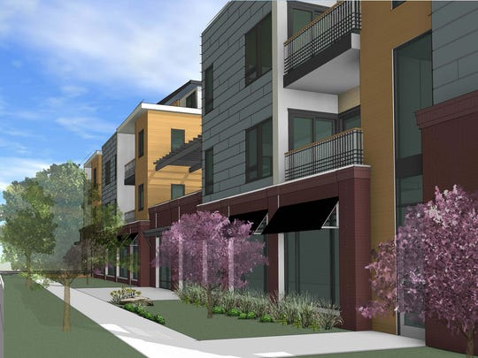 A rendering of a proposed 29-unit condominium and office project at the corner of Meldrum and Maple streets. The project was denied by a city hearing officer and appealed to the City Council.
