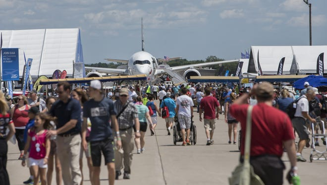 The crowd attends attractions on Boeing Plaza at EAA's AirVenture in Oshkosh last year. The event has a huge economic impact on the Fox Valley region.