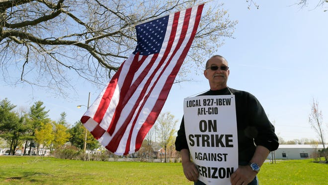 Rich Wysokinski of Middletown and fellow Verizon workers picket outside of the Verizon location on Shrewsbury Avenue in Tinton Falls Monday.