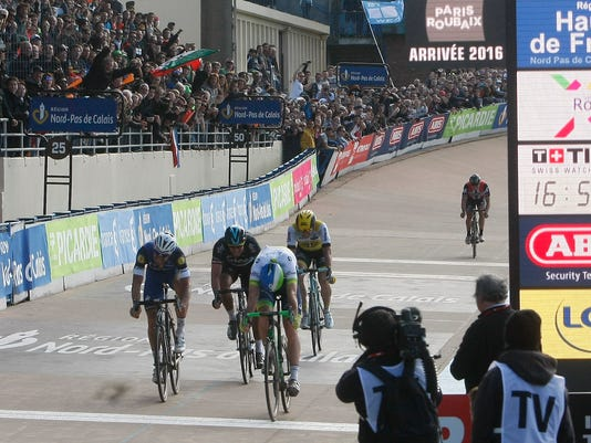 Matthew Ayman of Australia, Oreca Team, front right, wins the 114th edition of the Paris-Roubaix cycling classic, a 257.5 kilometer (160 mile) one day race, with about 20 per cent of the distance run on cobblestones, at the velodrome in Roubaix, northern France, on Sunday, April 10, 2016. (AP Photo/Michel Spingler)