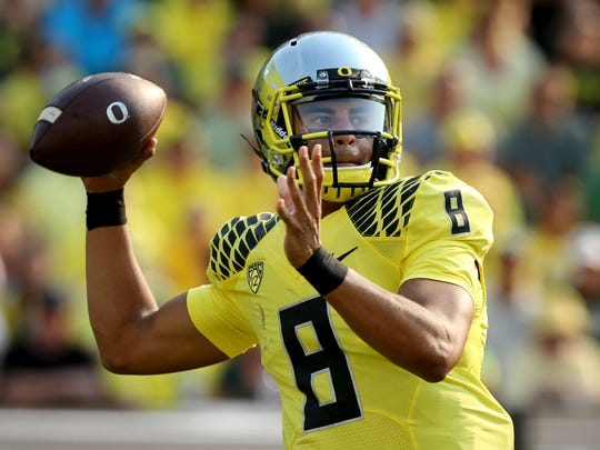 Oregon quarterback Marcus Mariota, The Associated Press college football player of the year, is in the first College Football Playoffs.