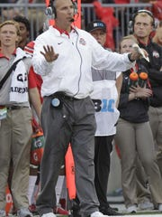 Ohio State head coach Urban Meyer shouts instructions