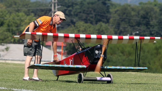 Richard Landis of New City readies a model World War I Fokker D7 airplane during the 7th annual Town of Haverstraw Air Show at the Haverstraw Model Aerodrome Aug. 20, 2016. Dozens of spectators watched as thirty pilots flew dozens of model planes and helicopters. Those attending also had the opportunity to try their hands at flying a model airplane.
