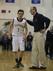 Clarkston's Foster Loyer listens to instructions from