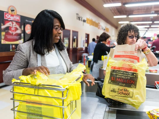 Dr. Yves Salomon-Fernandez, President of Cumberland County College, bags groceries at Shop Rite in Vineland on Wednesday, September 21.