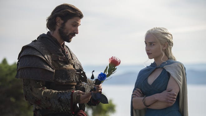 "Michiel Huisman and Emilia Clarke in a scene from ""Game of Thrones."""