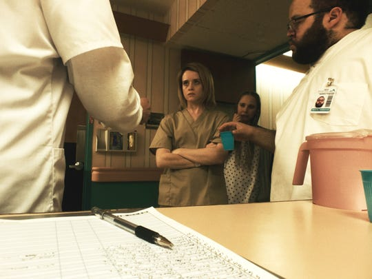 """In """"Unsane,"""" Sawyer (Claire Foy) is committed to a"""