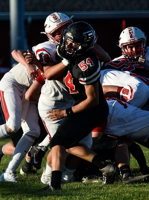 Pleasant defensive lineman Chase Creeger penetrates the Pandora-Gilboa offensive line in a win early this season. Creeger was named Central District Defensive Player of the Year in Division V.
