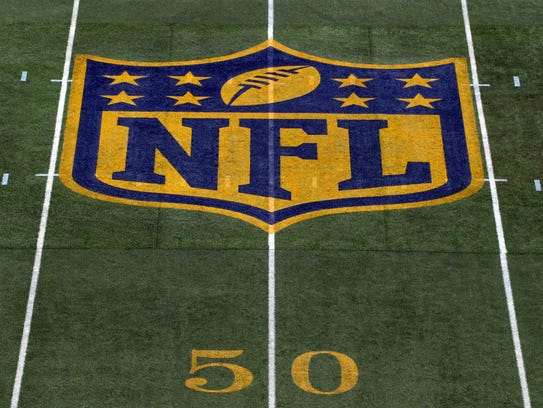 he NFL gold shield logo.
