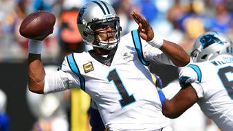 FILE - In this Sept. 9, 2019, file photo, Carolina Panthers quarterback Cam Newton looks for a receiver during the team's NFL football game against the Los Angeles Rams during the second half in Charlotte, N.C. The New England Patriots have reached an agreement with free-agent quarterback Newton, bringing in the 2015 NFL Most Valuable Player to help the team move on from three-time MVP Tom Brady, a person with knowledge of the deal told The Associated Press.