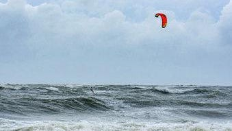 As Hurricane Dorian approaches Tybee Island on Sept. 4, 2019, a kiteboarder takes advantage of the large waves generated by the storm.